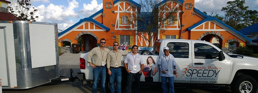 "Photograph of Speedy Floor Removal team standing in front of a truck helping with ""Give Kids The World Extreme Makeover"" project."