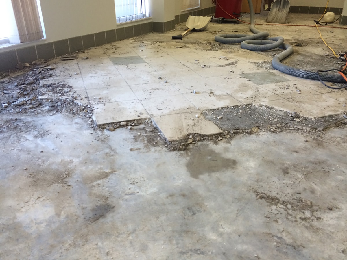 Photograph Of A Tile Floor Removed By Speedy Floor Removal Of