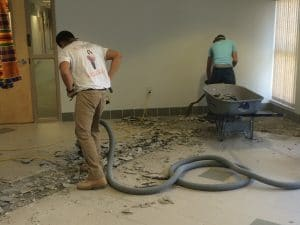 Speedy Floor Removal begins removing tile floor in a children's hospital.