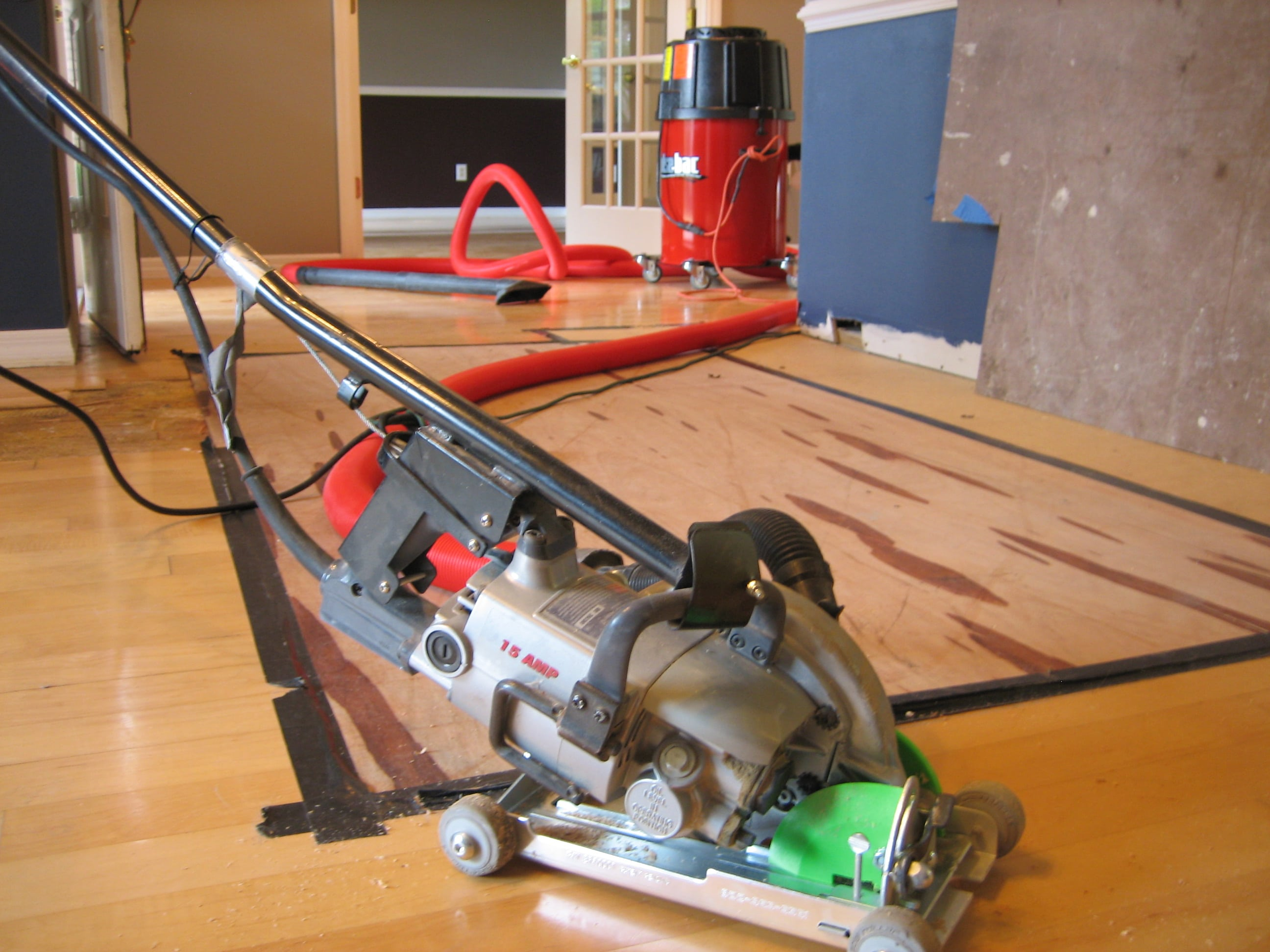 Image of hand-held wood floor removal machinery