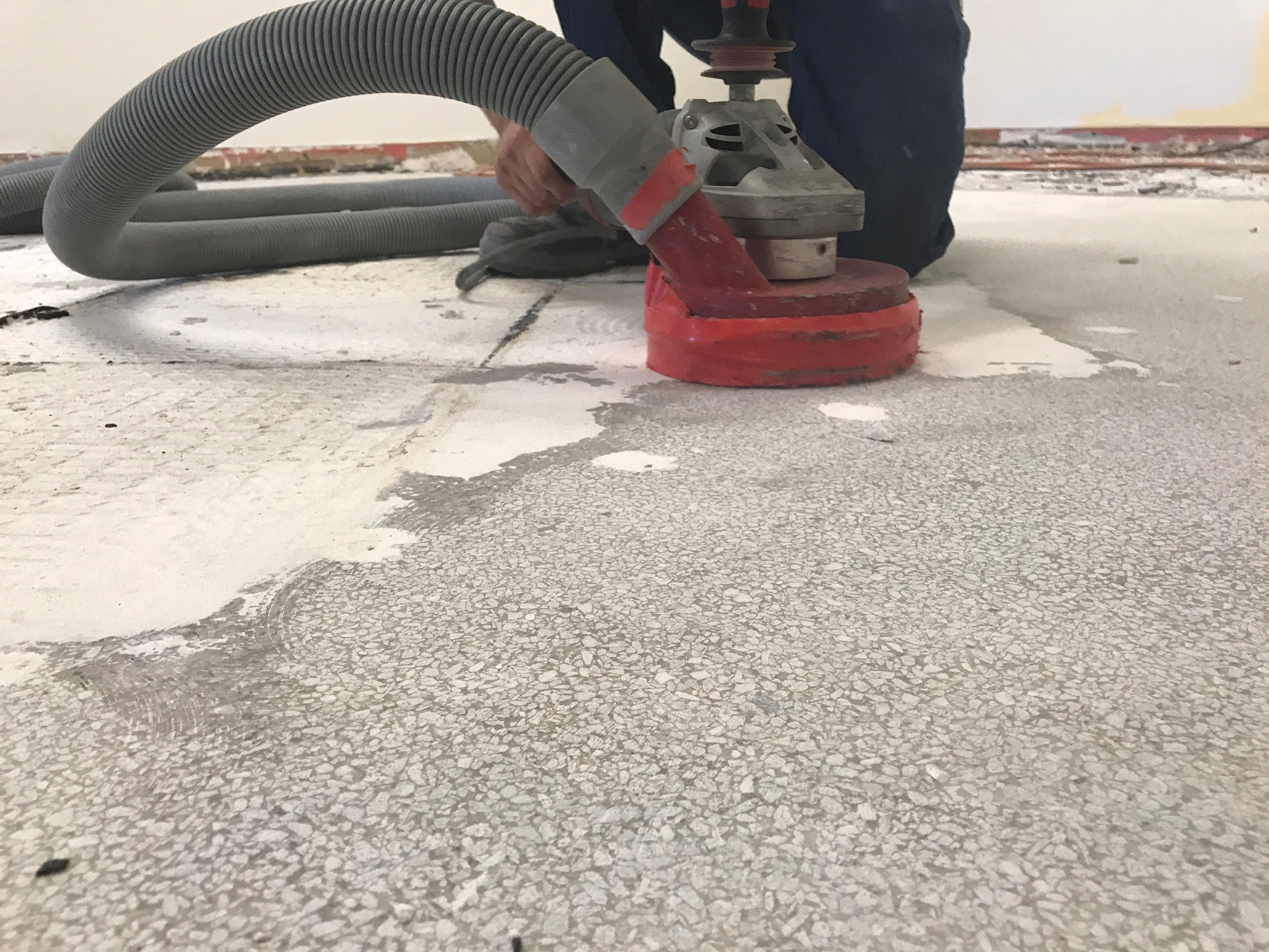 Close-up image of concrete sub-floor being buffed smooth