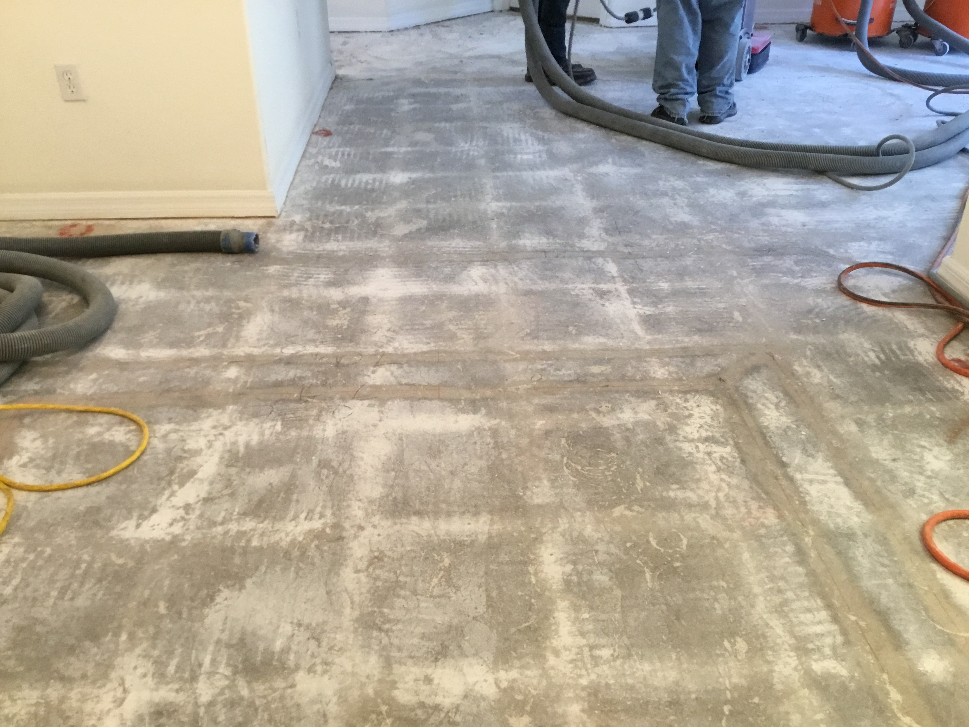 Image of a smooth concrete sub-floor after thin-set and tile floor removal