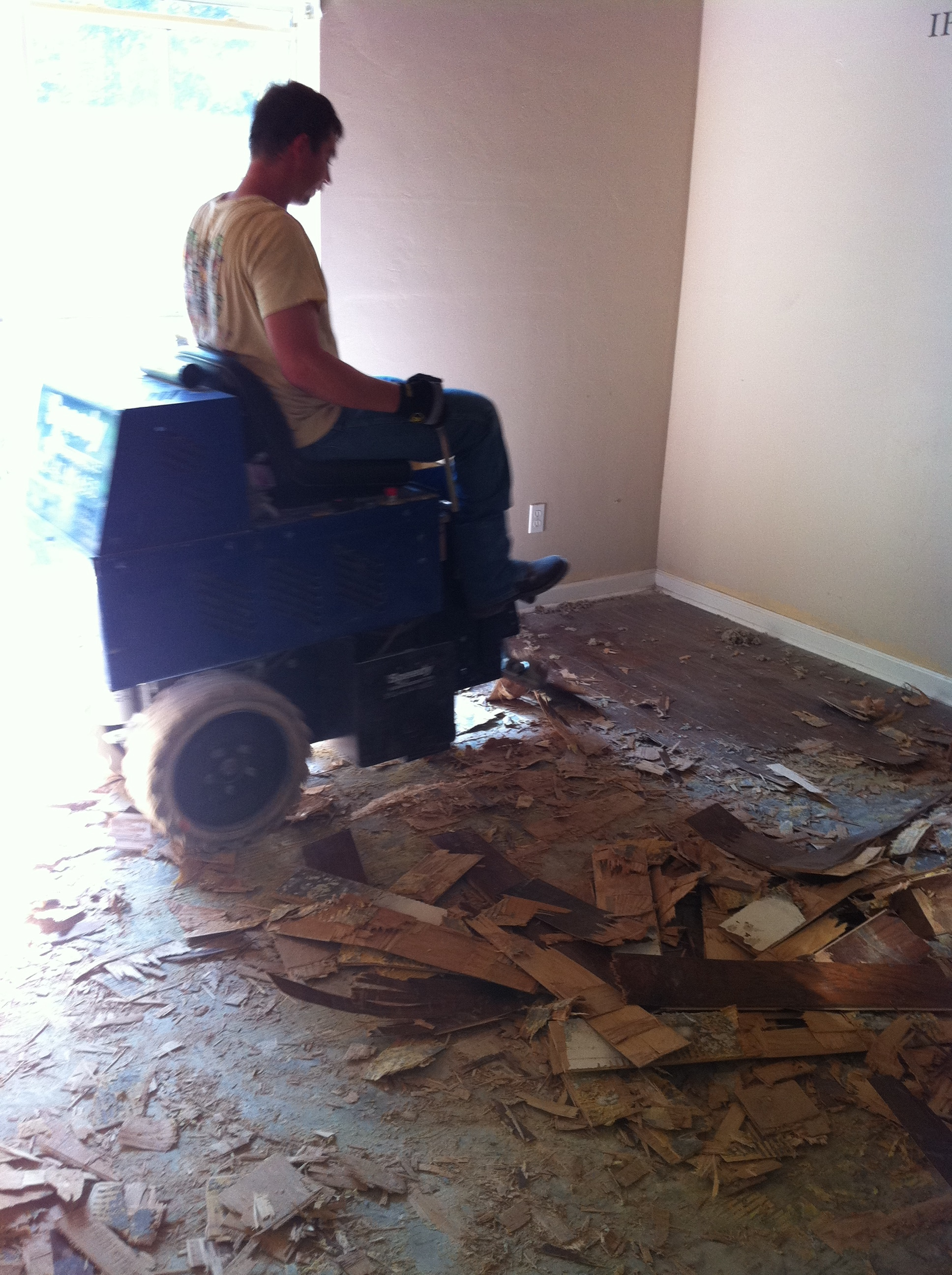 Image of ride-along wood floor removal machinery