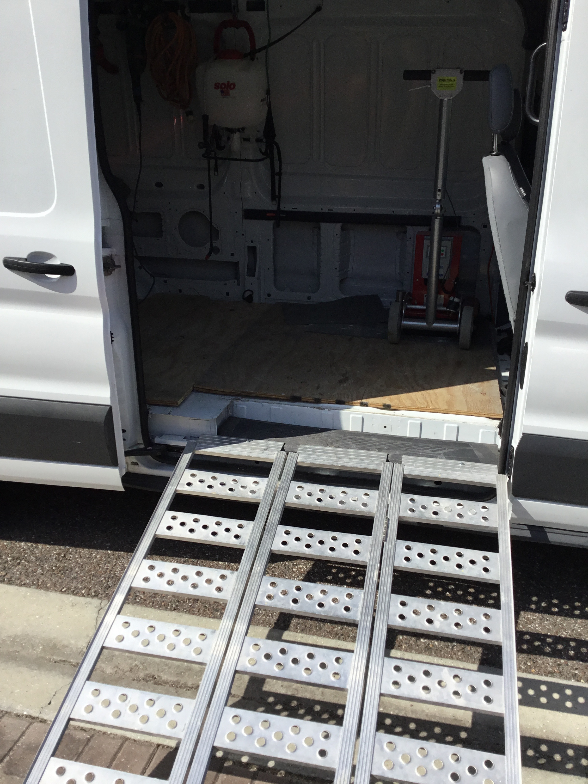 Close-up image of a custom ramp leading in to a Speedy Floor Removal truck
